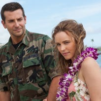"Bradley Cooper (left) and Rachel McAdams in a scene from ""Aloha."""