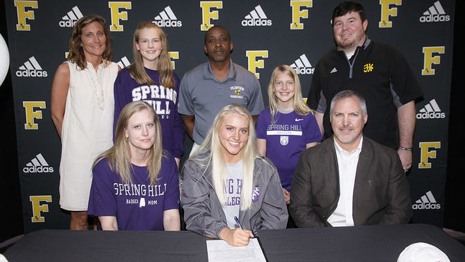 Fairview High School senior Audrey Cox (center front row) signs to play basketball with the Spring Hill Badgers April 13, 2018. Pictured - back row (l-r) - Coach Morgan Brown, Hallie Cox, Coach Wayne McGowan, Ruby Cox, Assistant Principal Chris Butler; front row -Kara Cox, Audrey Cox and David Cox.