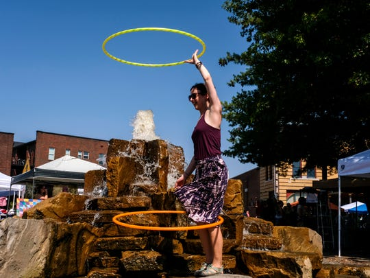 Abbi Killebrew, known also as Absmarie, hoop dances around the Haynie's Corner fountain during the 15th annual Funk in the City in Evansville, Ind., on Saturday, Sept. 23, 2017. She runs a business called Hoops of a Feather and teaches people of all ages and skill levels how to hoop dance.