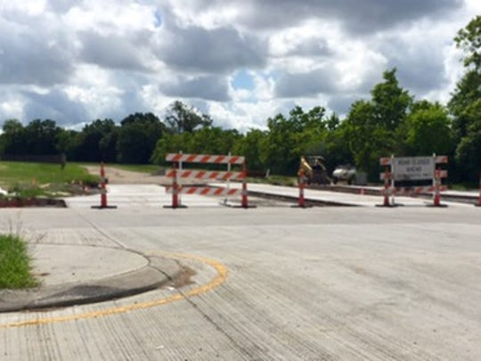 Road work continues on Town Center Parkway access to Rue de Belier.