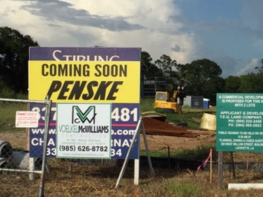 A sign for the forthcoming Penske Rentals is shown.