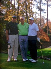 An avid golfer, David Wujczyk, right, playing the Augusta