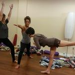 Charlotte O'Brien, Christine Brasacchio and Aja Reeser of Yoga Bird, Fort Myers practice Warrior I, Warrior II and Warrior III.