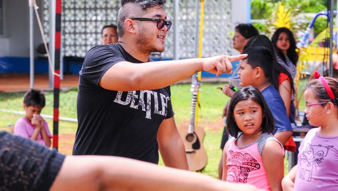 """Director Nicolas Quinata instructs actors during a rehearsal of """"Pulani"""" at the Island Girl Power compound in Dededo on July 8. Rick Cruz/PDN"""