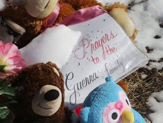 Students at Holy Cross Central School have raised $1,025 for give to the Guerra family. 6 members of the Guerra family died from a fire in their home on the 21 block of north Olney St. Here stuffed animals and other items left in remembrance for the family on the lawn of the home.
