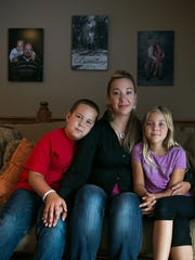 Amanda Buenting with her children Ethan, 11, and Kalie, 9, at their home in Rockwell City.