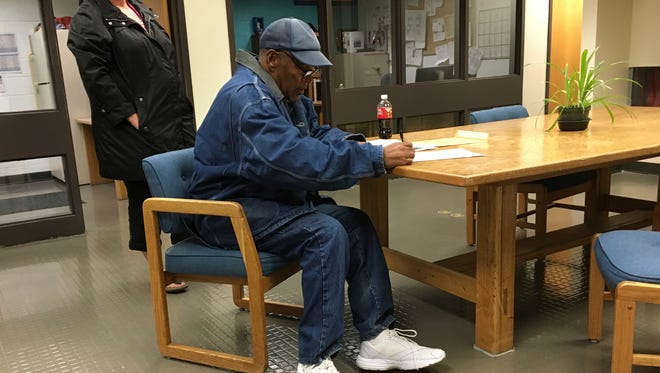 O.J. Simpson signs documents at the Lovelock Correctional Center on Sept. 30 in Lovelock, Nev.