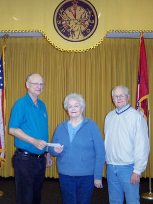 The Mountain Home Elks Lodge recently donated $250 to the Twin Lakes Literacy Council for their Children's Tutoring Program. Shown are (from left) Don Swanson, Elks president; Lana Ellibee, TLLC board member, and Butch Holligan Elks Benevolence committee member.