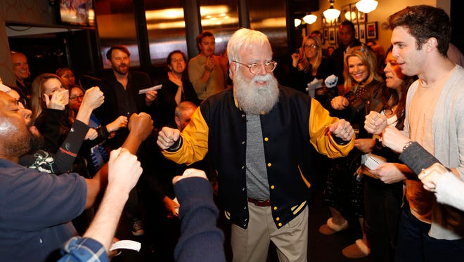 """Dave Grohl shows off his David Letterman costume when greeting """"Jimmy Kimmel Live"""" fans on Halloween."""