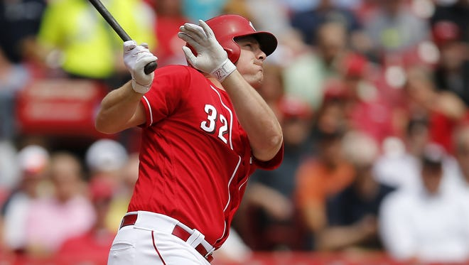 Cincinnati Reds right fielder Jay Bruce (32) hits a two-run home run in the second inning during the MLB game between the Colorado Rockies and the Cincinnati Reds, Wednesday, April 20, 2016, at Great American Ball Park in Cincinnati.