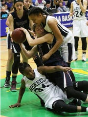 Watkins Glen's Taylor Kelly battles Mekeel Christian's Liz Singleton (34) and Jesse Show for a loose ball under the Senecas basket during the second quarter of Saturday's Class C state semifinal in Troy.