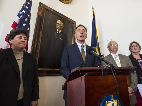 Gov. Peter Shumlin, center, speaks during a news conference in Montpelier on Thursday, April 14, 2016, after the Securities and Exchange Commission alleged that Ariel Quiros, owner of the Jay Peak resort and Bill Stenger, president and CEO of Jay Peak, misused more than $200 million of EB-5 immigrant investor funds.  With Shumlin are, from left, Susan Donegan, commissioner of the Vermont Department of Financial Regulation; Attorney General William Sorrell and Secretary of Coomerce Patricia Moulton.