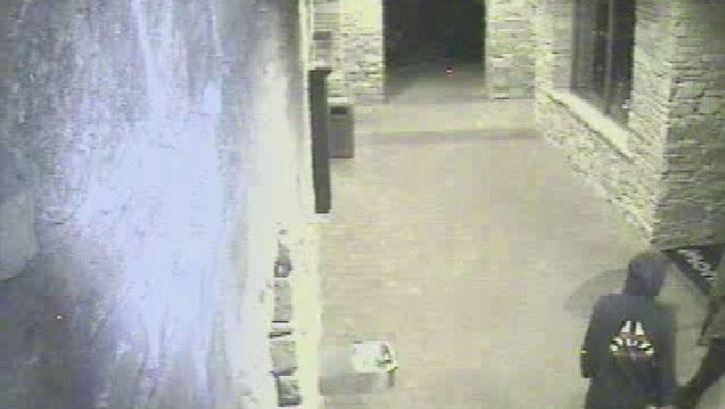 Surveillance photo from a May 4 incident at Montreux Golf and Country Club showing the distinct pattern on the back of one suspect's backpack