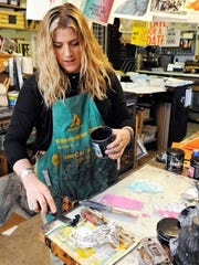 Artist Mary Bruno mixes ink for a printing project March 17 at Bruno Press in St. Joseph.