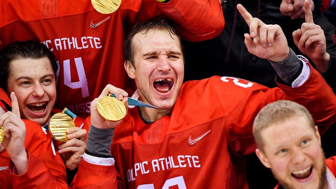 Russia defenseman Andrei Zubarev (28) celebrates after defeating Germany in the men's ice hockey gold medal game.