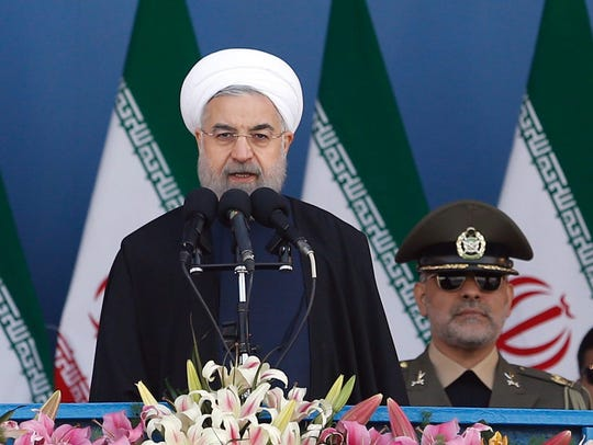 Iranian President Hassan Rouhani speaks during a ceremony