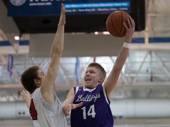 Rumson's Jackson McCarthy goes up with shot as Haddonfiel'd Aiden Blake defends during the NJSIAA Group II semifinals in Toms River.