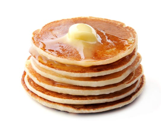 Pancakes on white background.