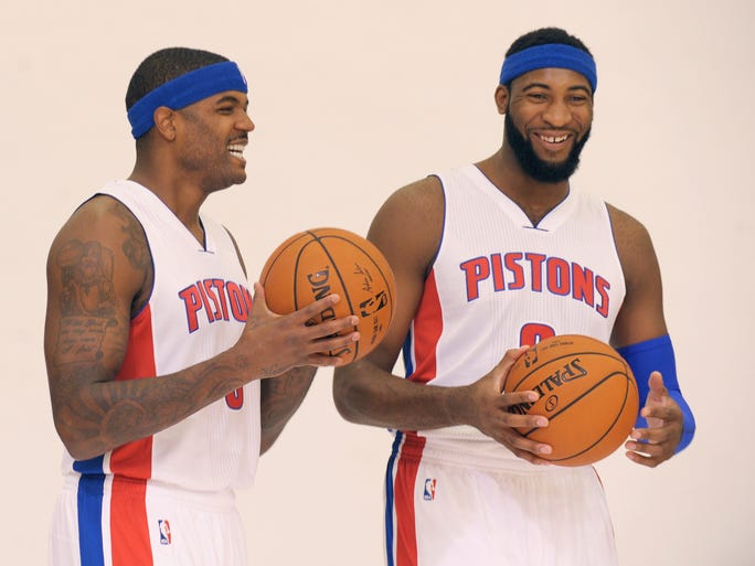 The Pistons' Josh Smith, left, and Andre Drummond joke around during a photo shoot.