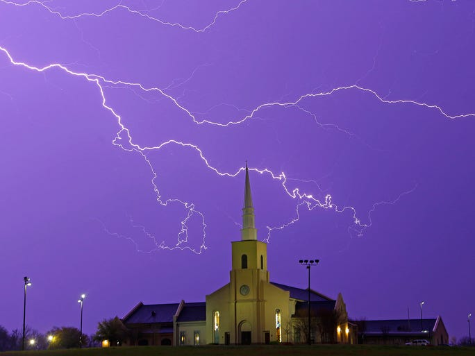 Lightning steaks across the sky behind the Young Meadows Presbyterian Church on March 18 in Montgomery, Ala., as strong storms moved across the state, bringing hail, high winds and heavy rainfall.