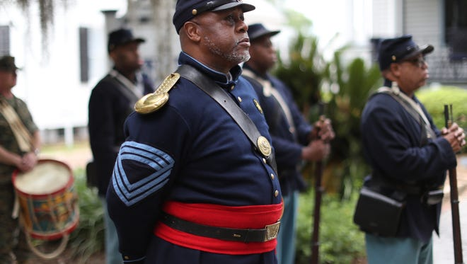 Jarvis Rosier, dressed in Civil War era second infantry regiment of the U.S. colored troops uniform with fellow reenactors at the Knott House Museum downtown during a celebration of the anniversary of the reading of the Emancipation Proclamation Sunday, May 20, 2018.
