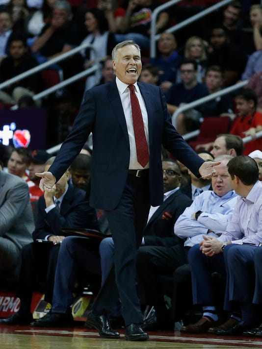 Houston Rockets head coach Mike D'Antoni disagrees with the officials call against the Portland Trail Blazers in the first half of an NBA basketball game on Thursday, Nov. 17, 2016, in Houston. (AP Photo/Bob Levey)