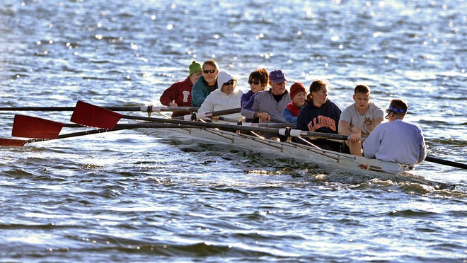 Members of the Pensacola Rowing Club row across Bayou Texar. The group is helping to put together the first International Coastal Rowing tournament in the United States at Pensacola Beach.
