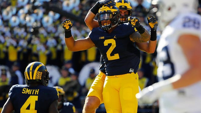 Michigan freshman tight end Devin Asiasi celebrates his first college touchdown on Saturday, Sept. 24, 2016 against Penn State. Asiasi is from California and chose the Wolverines last winter over UCLA, USC and Washington.