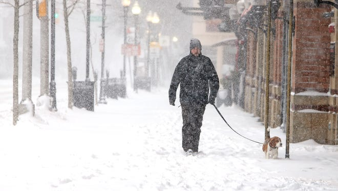 Bryan Lebaron and R.B. go for a walk along W. Park Place in Morristown as the first winter storm of the season is predicted to drop more than a foot of snow in parts of New Jersey.   February 9, 2017, Morristown, NJ.
