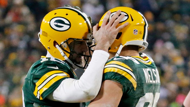 In this Dec. 11, 2016, file photo, Green Bay Packers' Aaron Rodgers congratulates Jordy Nelson after a touchdown catch during the second half of an NFL football game against the Seattle Seahawks, in Green Bay, Wis.