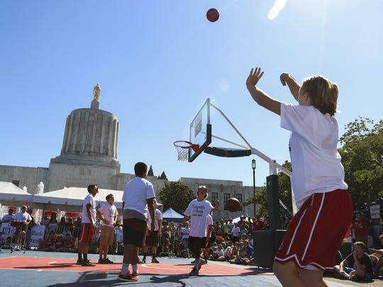 Natalie Turnbull shoots in the Columbia Bank 3-Point Shootout Finals at Hoopla on Saturday, Aug. 6, 2016. The 18th annual Oregon National Guard Hoopla is one of the nation's largest 3-on-3 basketball tournaments.