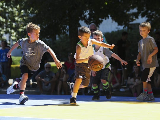 Young players drive towards the basket in the Hoopla 3x3 Tournament Games on Saturday, Aug. 6, 2016. The 18th annual Oregon National Guard Hoopla is one of the nation's largest 3-on-3 basketball tournaments.