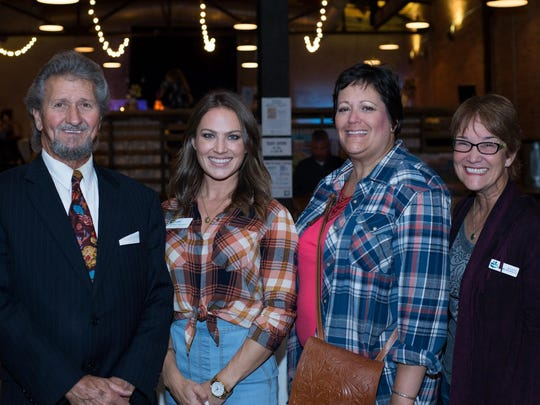 Ralph Burns, Madison Bankston, Friends of Literacy executive director Melissa Nance and Mary Fran Darwin at the Standard for Boots, Buckles and Books fundraiser.