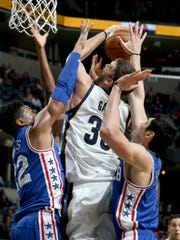 Memphis Grizzlies Marc Gasol (center) shoots and is