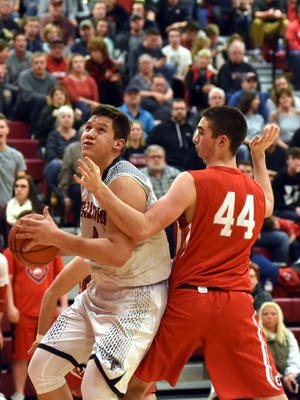 Colin Woodside prepares to shoot against Sheridan's Grant Heileman during host Fairfield Union's 64-50 win on Monday night. Woodside scored nine fourth-quarter points.