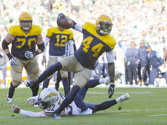 Green Bay, WI, USA; Green Bay Packers running back James Starks (44) rushes for a touchdown during the first quarter against the San Diego Chargers at Lambeau Field.