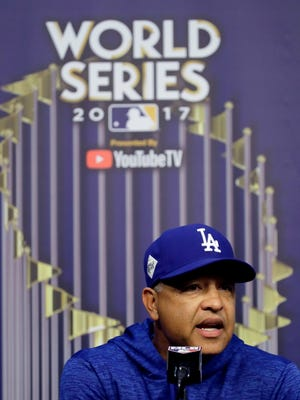 Dodgers manager Dave Roberts talks to the media.