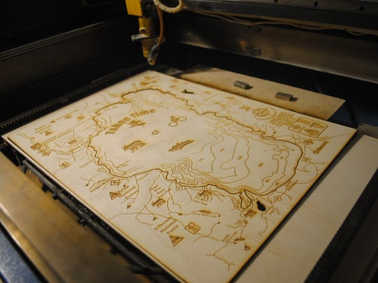 Roger Floren uses a wood mill and a three-dimensional laser to create a layered replica of Lake Tahoe. The outer top piece shown Monday in Sparks at the Bridgewire art incubator studio will be used in a replica, and the inner piece will be used to create a Lake Tahoe clock.