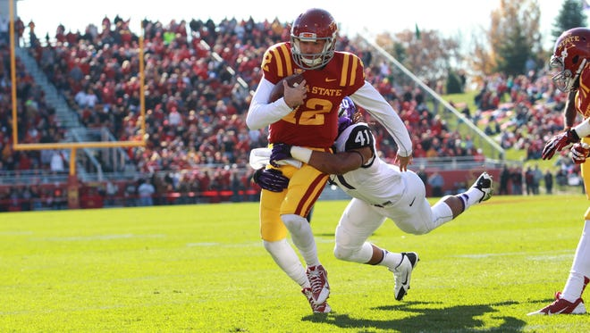Texas Christian Horned Frogs linebacker Jonathan Anderson (41) tackles Iowa State Cyclones quarterback Sam Richardson (12) during a 2013 game.
