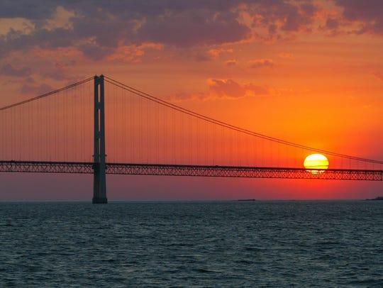 The sun sets over the Mackinac Bridge and the Mackinac
