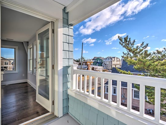 A set of french doors leads to the balcony for a scenic view.