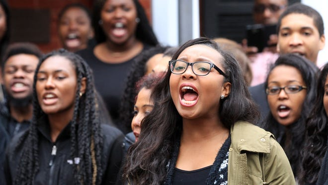 Students chant outside the African American Affairs building after marching out of Newcomb Theater during a forum about the recent arrest of student Martese R. Johnson on March 20, 2015, in Charlottesville, Va.