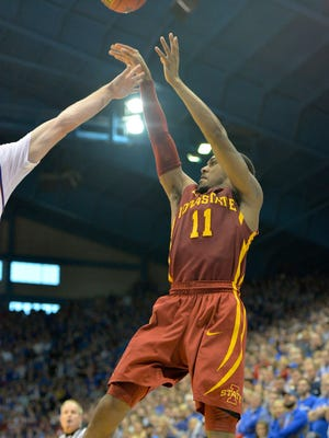 Iowa State Cyclones guard Monte Morris (11) shoots a jump shot during the second half agaisnt the Kansas Jayhawks at Allen Fieldhouse. Iowa State won 92-89.