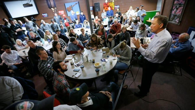 Republican presidential candidate, Ohio Gov. John Kasich speaks during a campaign stop at the Inspired Grounds Cafe, Monday, Jan. 4, 2016, in West Des Moines, Iowa. (AP Photo/Charlie Neibergall)