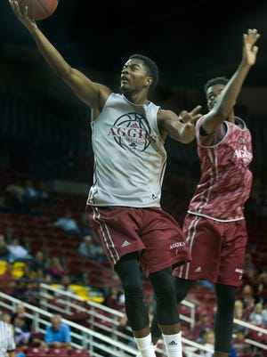 New Mexico State's Braxton Huggins, left, will be one of the sophomores who could be in a key role for the Aggies this season.