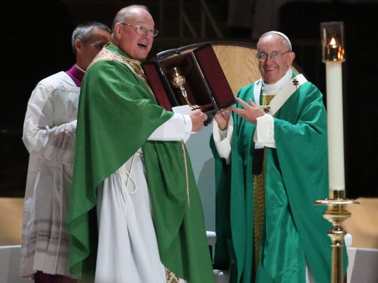 Pope Francis gives Cardinal Timothy Dolan a chalice at the end of the Celebration of the Eucharist for the Preservation of Peace and Justice at Madison Square Garden, Sept. 25, 2015.
