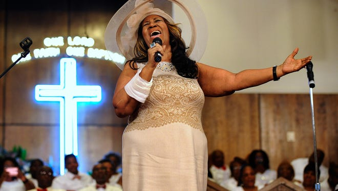 Aretha Franklin sings during a memorial service for her father and brother, Rev. C.L. and Rev. Cecil Franklin, at New Bethel Baptist Church, where they were ministers, in Detroit, Michigan, on Sunday, June 7, 2015.