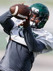 Cordova High School receiver Jacolby Hewitt makes a catch will running through drills during a recent team practice.