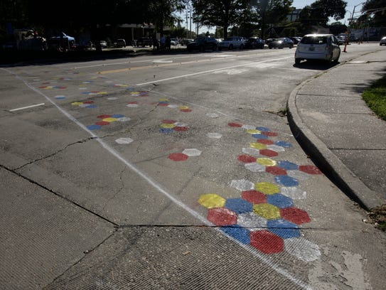 A colorfully painted new crosswalk on West Congress