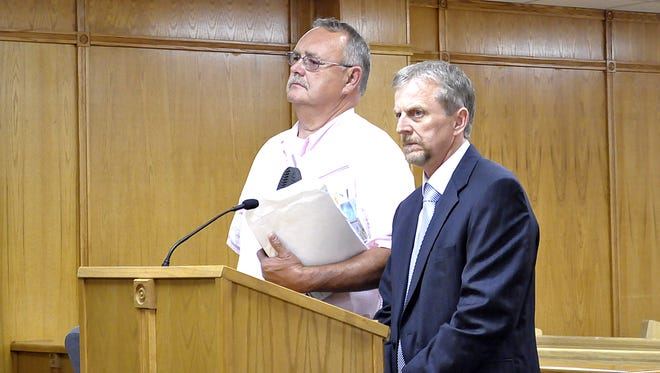 Convicted child rapist William Bardin (left) and his attorney David Ethredge listen Thursday as Circuit Court Judge Gordon Webb sentenced the 63-year-old Cotter man to 20 years in prison for raping a girl under the age of 14.